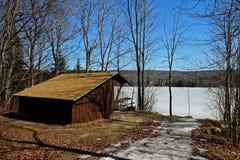 Campsite on a lake Stock Photos