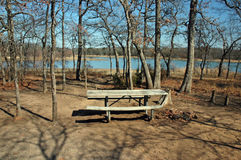 Campsite at the Lake. A deserted campsite in the woods near the shoreline of a lake Stock Images