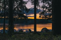 Campsite by lake at sunset