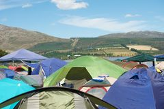 Campsite. Many tents placed in countryside campsite Royalty Free Stock Photo