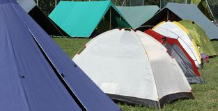 Campsite with many tents and shelters for people Stock Photography