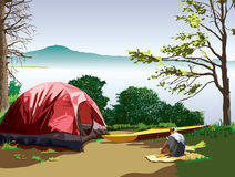 Campsite at Moss lake. A lakeside campsite with a tent and a kayak. A girl is sitting on a blanket reading a book. A mountain is visible across the lake. A Royalty Free Stock Image