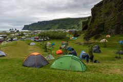 The campsite near Vik, Iceland. A photo of a campsite near little icelandic town Vik with a view of impressive rock formation Reynisdjangar Royalty Free Stock Image