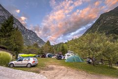 Campsite in orchard at sunset. BOVEC, SLOVENIA, AUGUST 7 2017: Campsite in orchard at sunset in Triglav National Park in Julian Alps of Slovenia, Europe stock photography
