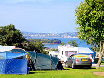 Campsite, Paignton, Devon. A campsite overlooking the beautiful Torbay with Torquay in the background at Paignton, English Riviera, Devon, England, UK royalty free stock photo