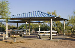 Campsite picnic ramada. Camping ramadas with picnic tables and grill stock image
