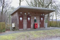 Campsite public toilets male female wood forest building for walkers campers scouts guides Royalty Free Stock Photos