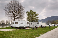 A campsite for RVs at the bank of the river Danube opposite the town Duernstein. Lower Austria. Stock Photos