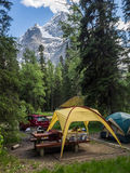Campsite with snow capped mountain Stock Images