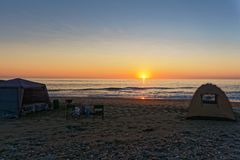 Campsite at sunset on the Skeleton Coast, Namibia. Meob Bay campsite at sunset on the Skeleton Coast, Namibia, Africa stock image