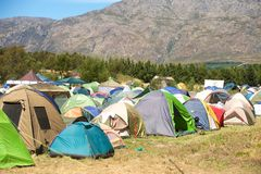 Campsite with tents on grass Stock Photography