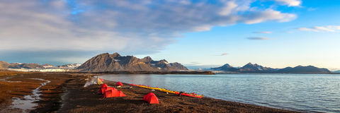 Campsite tents in Svalbard at midnight Stock Image