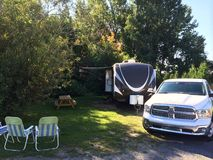 Campsite travel trailer pick up truck summer Stock Image