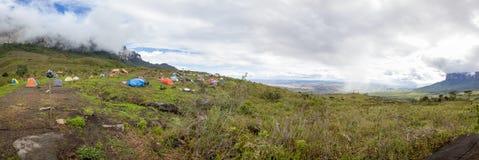 Campsite on the way to Roraima tepui, Gran Sabana, Venezuela. Panorama of campsite on the way to Roraima tepui at dawn with cloudy sky. Gran Sabana. Venezuela Stock Photo