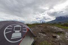 Campsite on the way to Roraima tepui, Gran Sabana, Venezuela. Campsite under the rain on the way to Roraima tepui at dawn with cloudy sky. Gran Sabana. Venezuela royalty free stock photo