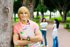 Campus. Young students relaxing in university campus Stock Images