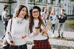 Campus. Books. Coffee. Girls. Happy Together royalty free stock image