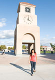 Campus Clock Tower With Student Walking Stock Photos