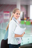 On campus - pretty, female student with books and laptop Royalty Free Stock Photos