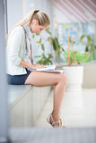On campus - pretty, female student with books Royalty Free Stock Photo