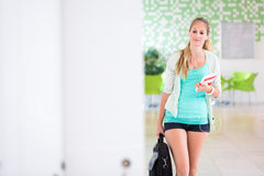 On campus - pretty, female student with books Stock Photo