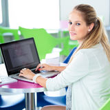 On campus - pretty, female student with books and laptop Royalty Free Stock Photo