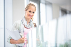 On campus - pretty, female student Royalty Free Stock Image