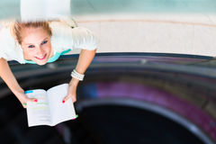 On campus - pretty, female student with books Stock Photography