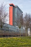 Campus Technical University Delft with buildings and field of narcissus Stock Photo
