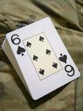 Camuflaje y una tarjeta Fotografía de archivo