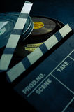 In the Can. A movie slate positioned beside a can of motion picture film Royalty Free Stock Image