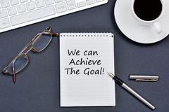 We can achieve the goal. Text on notebook. On a black background Royalty Free Stock Photography