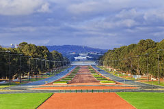 CAN Anzac Parade day. Perspective view along Anzac Parade in Australia's capital city Canberra on a sunny day. Modern city street from War Memorial to old and Royalty Free Stock Images