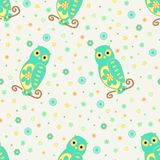 Funny seamless vector pattern with cartoon cute owls, flowers and hearts in yellow and green colors. Royalty Free Stock Photo