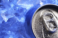 Can of beer in ice. In blue light Royalty Free Stock Photos