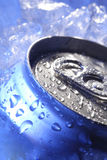Can of beer in ice. In blue light Royalty Free Stock Photography