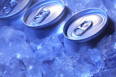 Can of beer in ice. In blue light Stock Photos
