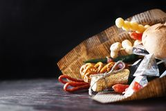 A can of beer with a snack on a wooden dark background . gift bouquet to a man. Men`s holiday gift Stock Photo