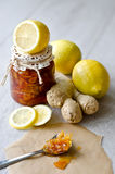 Can of citrus jam with ginger. A Can of lemon jam with ginger wooden background, selective focus Royalty Free Stock Images