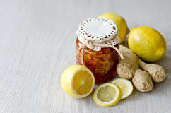 Can of citrus jam with ginger, natural medicine. A Can of lemon jam with ginger, copy space background Stock Photo