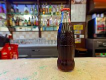 Bottle of Coca-Cola on a bar counter, ready to be served. Royalty Free Stock Photography