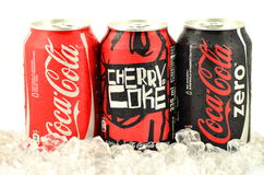 Can of Coca-Cola, Cherry Coke and Coca-Cola Zero drinks on ice. Stock Photos