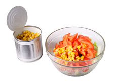 Can with corn and a salad dish with salad Stock Photo