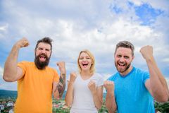 We can do it. Celebrate success. Ways to build successful team. Threesome stand happy with raised fists. Behaviors of. Winner team. Woman and men look royalty free stock image