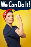We can do it photo rosie riveter. We can do it text bubble in photo of a strong and proud woman with a red headscarf rolling up her sleeve, perfect tribute to royalty free stock images