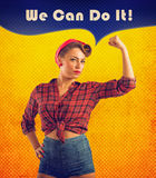 We can do it. Pin-up style woman show her muscular biceps Royalty Free Stock Photo