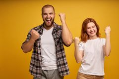We can do it. Successful team of coworkers clench fists, celebrate victory, exclaim positively, looks confident, have cheerful royalty free stock photos