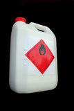 Can of flammable liquid. White plastic can with flammable warning label Stock Image