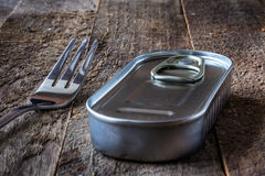 Can and fork on the table Royalty Free Stock Image