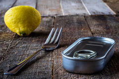 Can and fork on the table. In the old kitchen Stock Photo